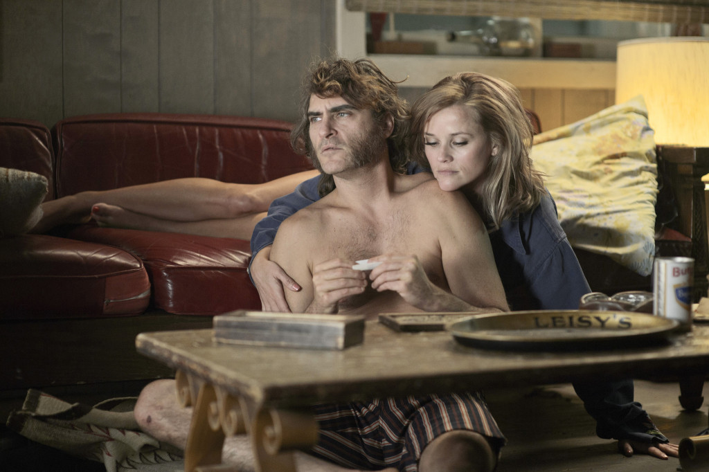 "(L-r) JOAQUIN PHOENIX as Larry ""Doc"" Sportello and REESE WITHERSPOON as Deputy D.A. Penny Kimball  in the movie INHERENT VICE, directed by Paul Thomas Anderson. Photo Credit: Wilson Webb"